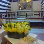 Flowers and Simnel Cake ready to be blessed.